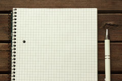 Notebook and pen. On wood texture Stock Photo