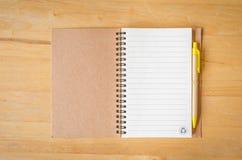 Notebook with pen Stock Photos