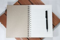 Notebook and pen on the wooden table Stock Image