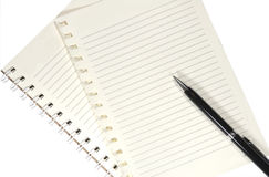 Notebook and pen on the wooden table Stock Photos