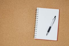 Notebook with pen on wooden table, business concept. royalty free stock photography