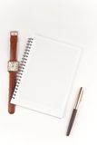 Notebook, pen and wristwatch Royalty Free Stock Photos