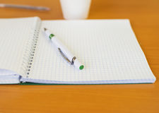 A notebook and a pen for writing lectures Stock Image
