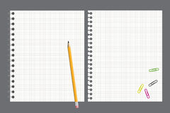 Notebook and pencil. Notebook pages torn out, a pencil and paper clips Royalty Free Stock Photos