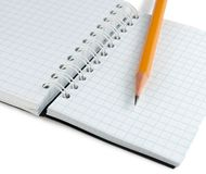 Notebook and pencil. Isolated on a white background Stock Photos