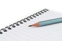 Notebook and pencil. On white Stock Photo