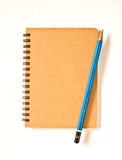 Notebook and Pencil. On white background Stock Photography