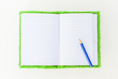 Notebook and Pencil. Velvet Notebook and Pencil on white background Royalty Free Stock Image