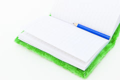 Notebook and Pencil. Velvet Notebook and Pencil on white background Stock Images