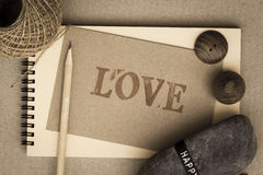 Notebook and pencil. With love card old style Stock Photography