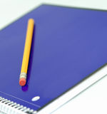Notebook and pencil. Pencil on purple notebook - shallow depth of field Royalty Free Stock Photos
