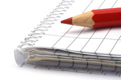 Notebook and pencil. Blank notebook and red pencil close up Royalty Free Stock Photos