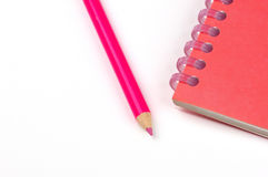 Notebook and pencil. A red notebook and pencil Stock Photography