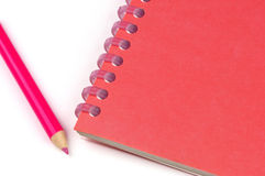Notebook and pencil. A red notebook and pencil Royalty Free Stock Photo