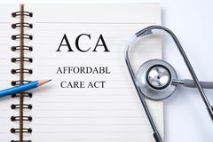 Notebook and pencil with ACA Affordable Care Act on the table Stock Photo