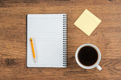 Notebook with pencil Adhesive Note and cup of coffee Royalty Free Stock Photo