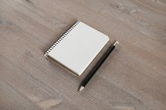 Notebook and pencil royalty free stock images