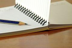 Notebook and pencil closeup Royalty Free Stock Photos