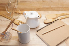 notebook with pencil,coffee cup,glass bottle and empty measuring Stock Images