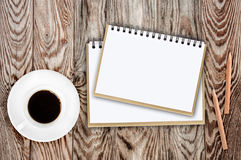 Notebook pencil coffee and flowers on table Royalty Free Stock Image