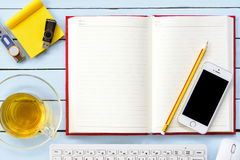 Notebook with pencil and equipment for work and tea cup.Top view. Royalty Free Stock Photography
