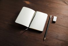 Notebook, pencil, eraser royalty free stock images