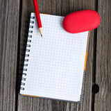 Notebook, pencil and eraser Stock Image