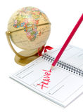 Notebook, a pencil and a globe on a white Stock Photos