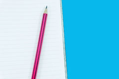 Notebook with pencil on green. Background Stock Photography