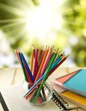 Notebook and pencil on green background Stock Photography