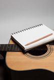 A notebook and pencil on guitar Stock Image