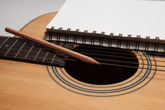 A notebook and pencil on guitar Royalty Free Stock Photo