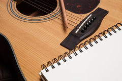 A notebook and pencil on guitar Royalty Free Stock Image