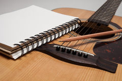 Notebook and pencil on guitar Royalty Free Stock Photo