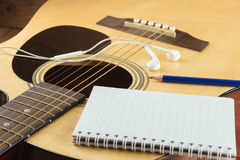Notebook and pencil on guitar, Writing music Royalty Free Stock Photography