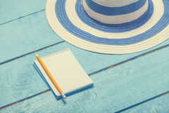 Notebook with pencil and hat Royalty Free Stock Photos