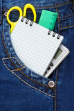 Notebook and pencil in jeans Stock Images