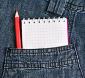 Notebook and pencil in jeans pocket Royalty Free Stock Photos