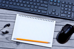 Notebook with pencil and keyboard computer Stock Images