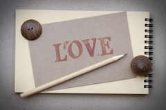 Notebook and pencil  with love card. Natural style Royalty Free Stock Photography