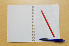 Notebook pencil and pen Royalty Free Stock Photography