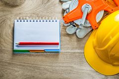 Notebook pencil protective gloves tape measure building helmet o Stock Photo