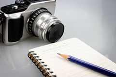 Notebook, pencil and retro camera Stock Image