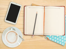 Notebook with pencil, smart phone and coffee cup Stock Photo
