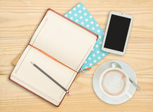 Notebook with pencil, smart phone and coffee cup Royalty Free Stock Photo