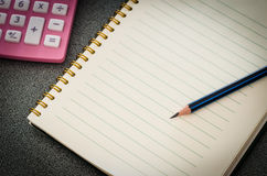 Notebook and pencil on table,Still life Royalty Free Stock Photos