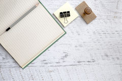 Notebook and pencil on textured background Royalty Free Stock Photo