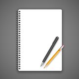 Notebook and pencil Stock Images