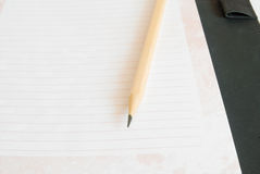 Notebook and pencil. On white background Royalty Free Stock Photo