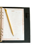 Notebook and pencil. On white background Stock Image